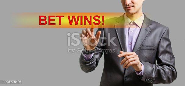 843298172 istock photo Euphoric happy businessman wear suit celebrate mobile win, 1205778426