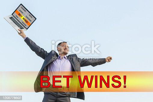 843298172 istock photo Euphoric happy businessman wear suit celebrate mobile win, 1205778502