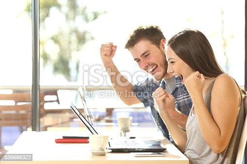 istock Euphoric students watching exam results 536666322