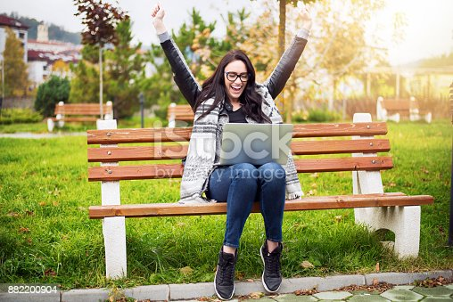493712130 istock photo Euphoric winner watching a laptop 882200904