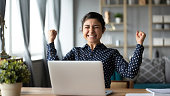 istock Euphoric young indian girl celebrate online victory triumph with laptop 1198252571