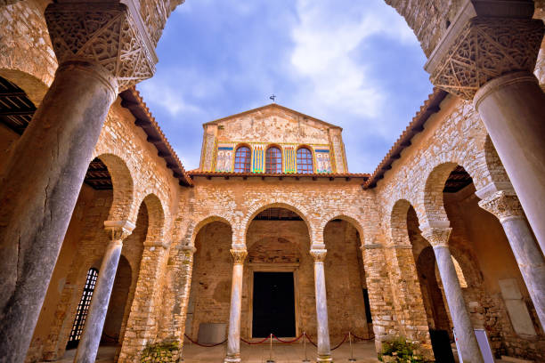 Euphrasian Basilica in Porec arcades and tower view, UNESCO world heritage site in Istria, Croatia Euphrasian Basilica in Porec arcades and tower view, UNESCO world heritage site in Istria, Croatia basilica stock pictures, royalty-free photos & images
