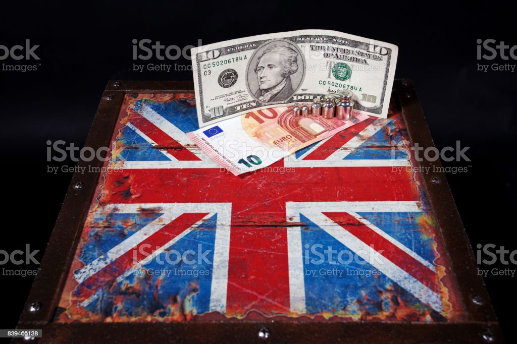 euro, american dollar and weights on British flag stock photo