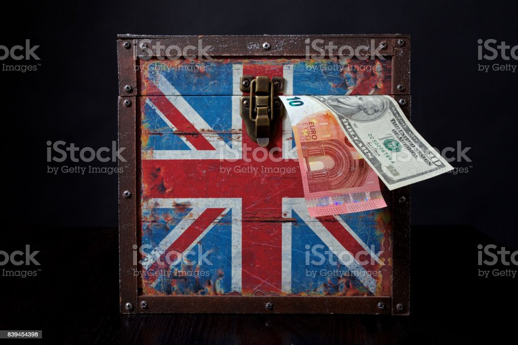 euro and american dollar on British flag stock photo