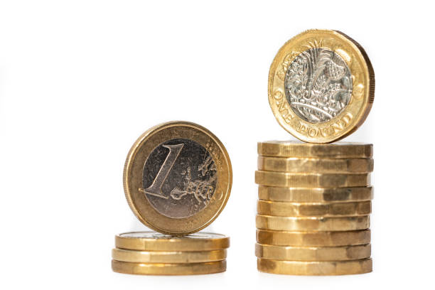Euro and British Pound Coins stock photo