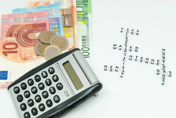 euro and calculator and words representing household monthly expenses concept photo stock photo