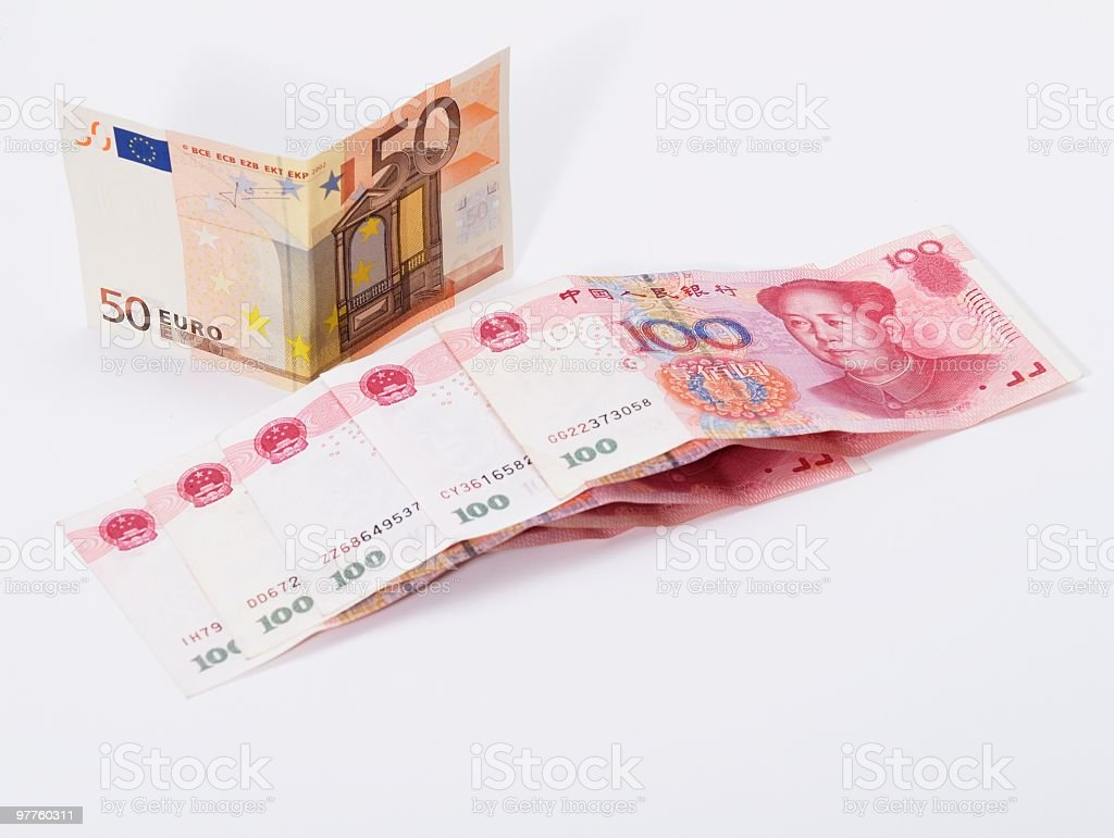 Euro and Chinese currency against white background stock photo