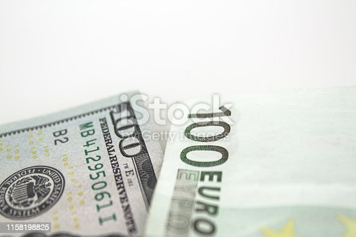 100 american dolar and 100 euro together on white background