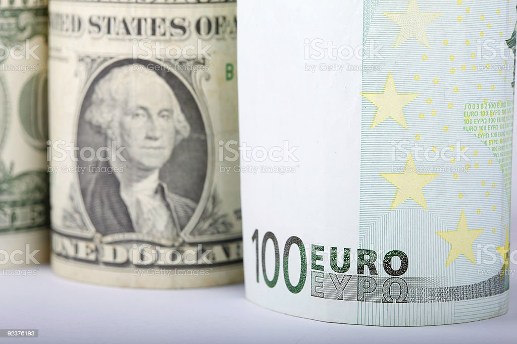 Euro and Dollar bill rolls royalty-free stock photo