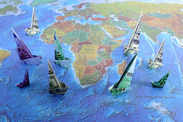 Euro and Dollar Paper Boats stock photo