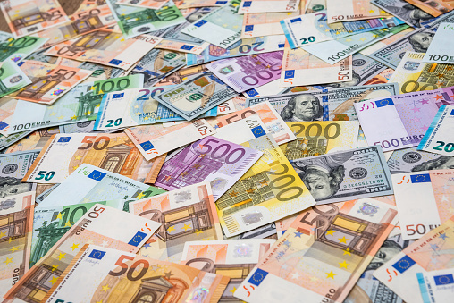 istock Euro and dollars banknotes  as background 1032599922