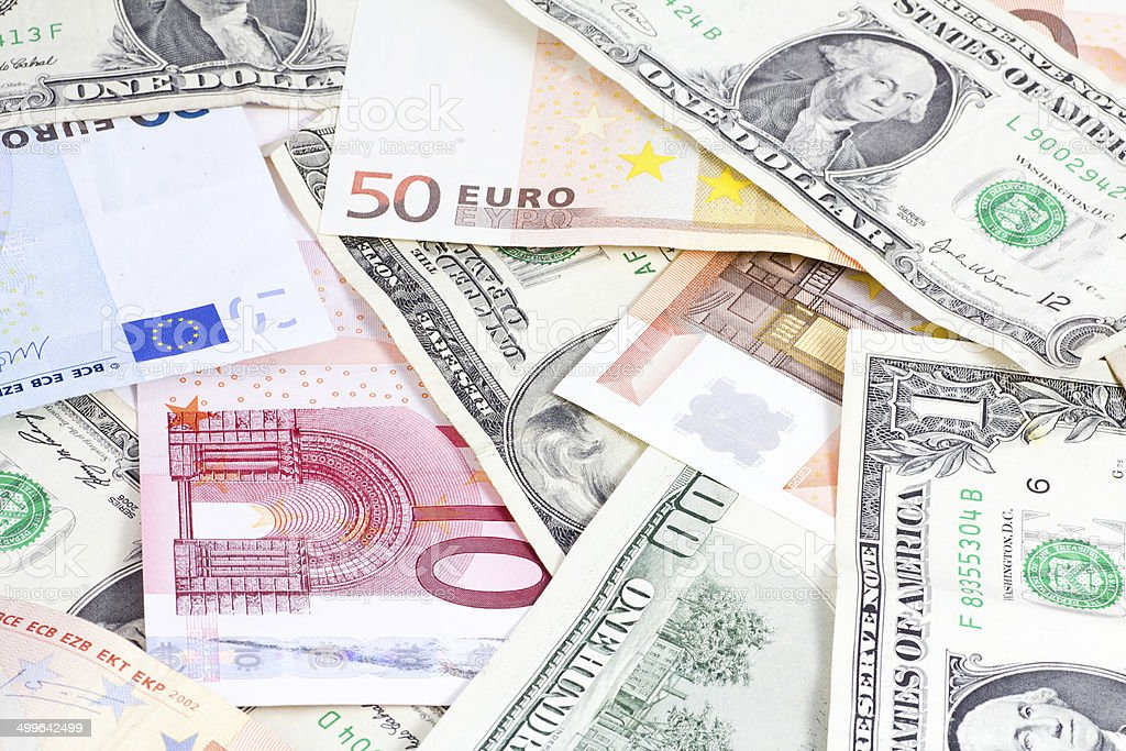 Euro and dollars bills stock photo