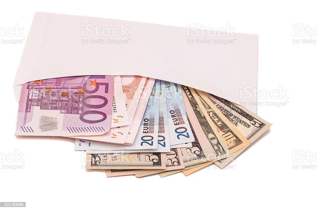 euro and dollars in open envelope stock photo