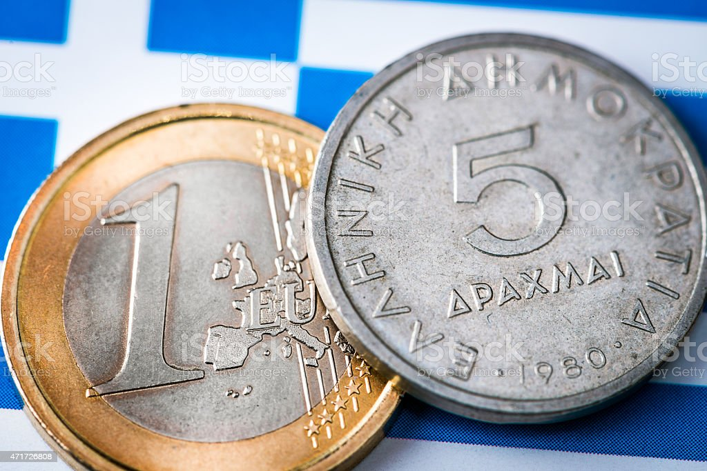Euro and Drachma coins on Greek and EU flags stock photo