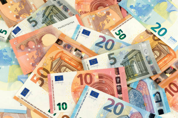 euro bank note currency finance background many euro bank note currency finance background euro symbol stock pictures, royalty-free photos & images