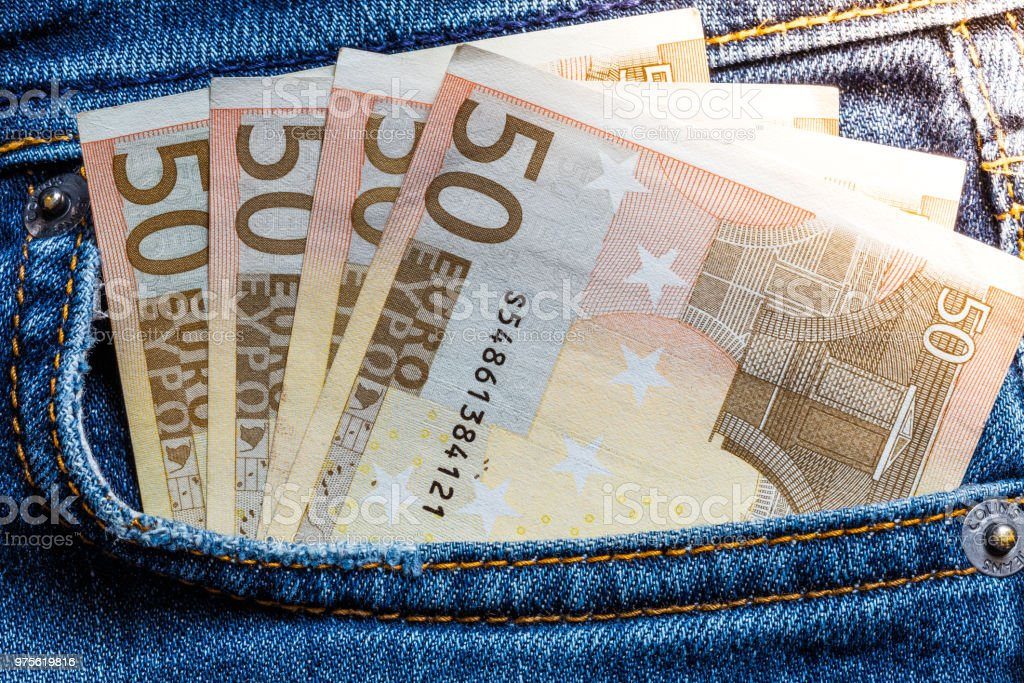 50 euro banknote in jeans pocket stock photo