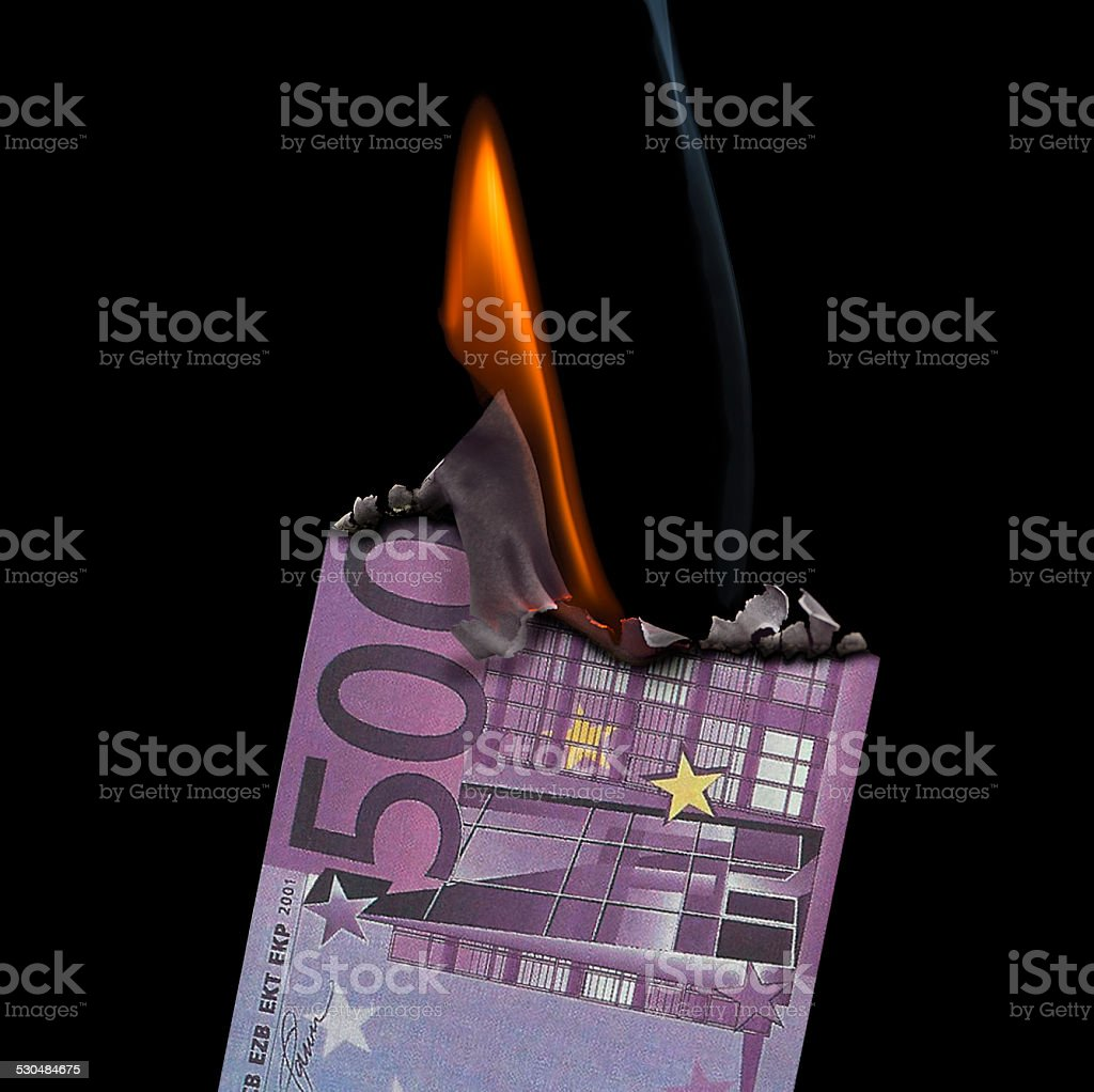 500 Euro Banknote on fire set on a  black background. stock photo