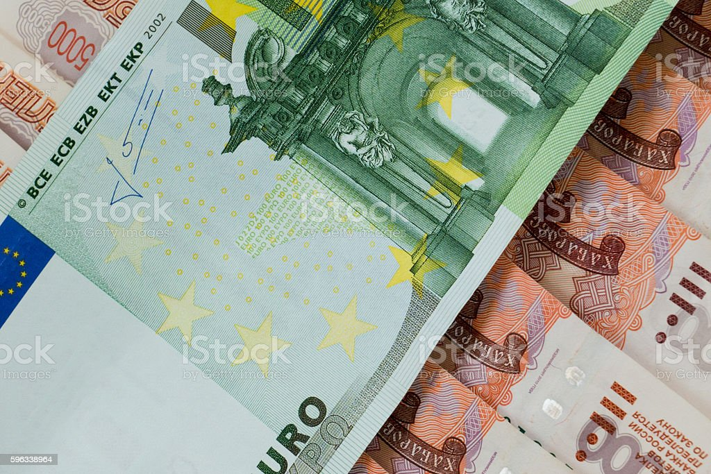 euro banknote on russian rubles royalty-free stock photo