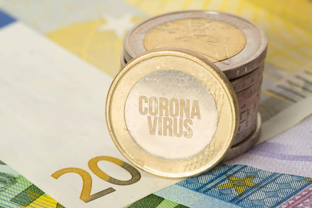 Euro banknotes and coins and coronavirus stock photo