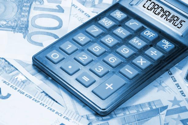 Euro banknotes, calculators and coronavirus stock photo