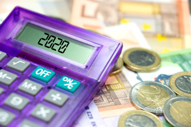 Euro banknotes, calculators and the year 2020 stock photo