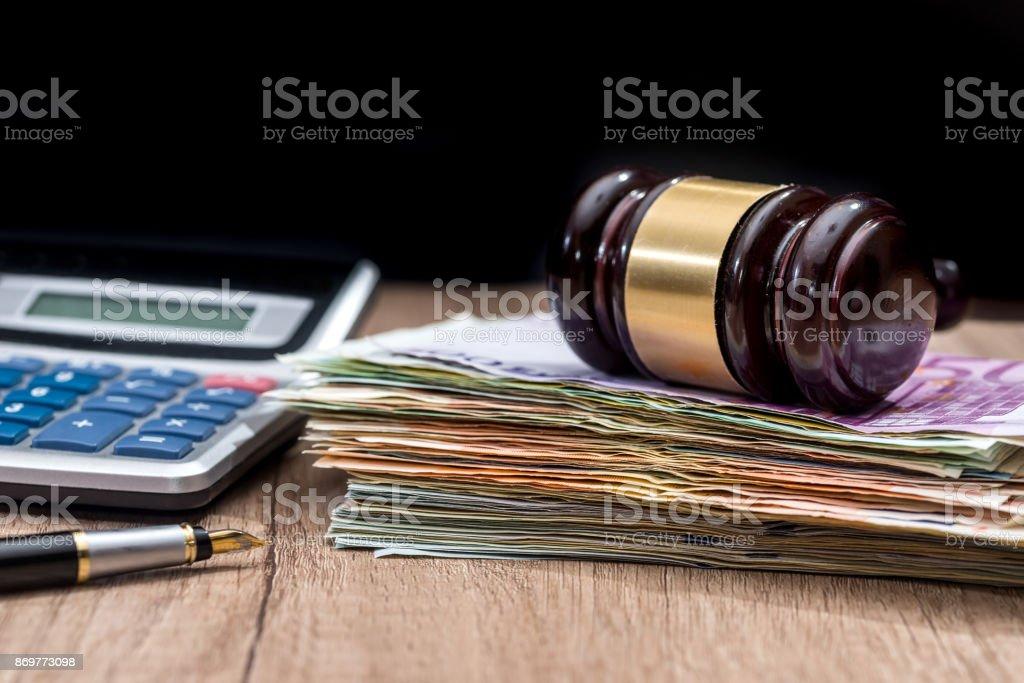 euro banknotes, gavel, calculator and pen stock photo