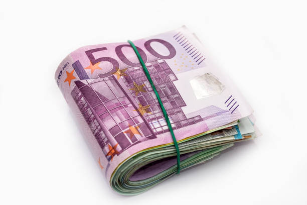 Euro banknotes in bundle isolated on white Euro banknotes in bundle isolated on white bundle stock pictures, royalty-free photos & images