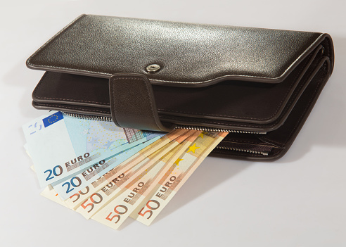 euro banknotes in leather purse