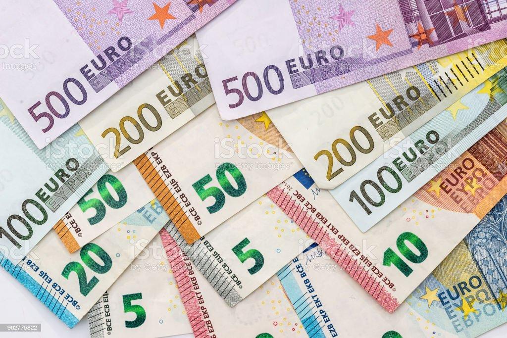 Euro banknotes isolated on white background, closeup - Foto stock royalty-free di Affari