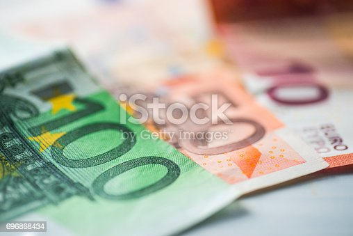 A handful of colorful euro banknotes.