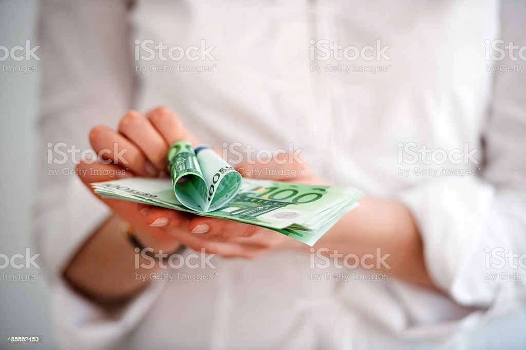 Euro banknotes with heart from hundred bill stock photo