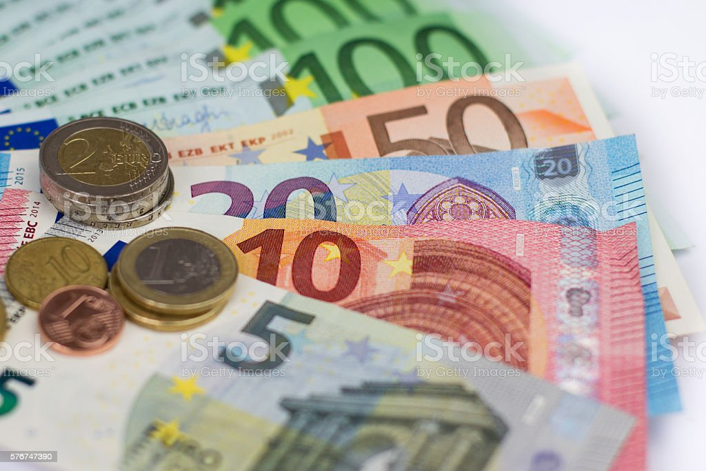 euro bills and coins - cash money stock photo