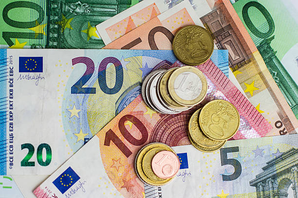 euro bills and coins - cash money euro bills and coins - cash money european union currency stock pictures, royalty-free photos & images