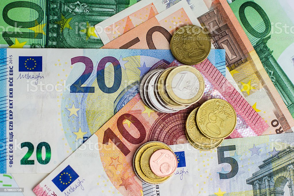 euro bills and coins - cash money - foto de stock