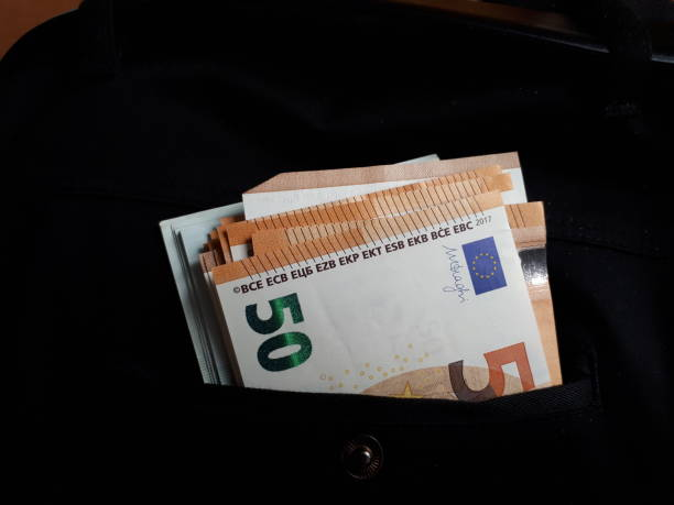 Euro bills in jeans pocket background. Euro banknotes in jeans back pocket. Concept of rich people, saving or spending money Euro bills in jeans pocket background. Euro banknotes in jeans back pocket. Concept of rich people, saving or spending money fifty euro banknote stock pictures, royalty-free photos & images