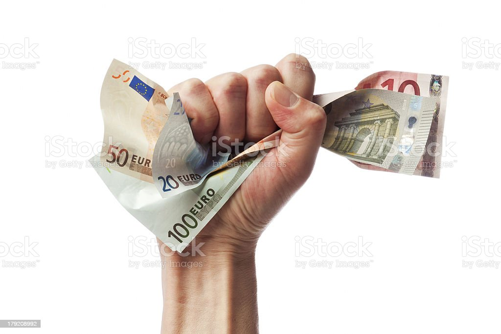 Euro bills in male fist royalty-free stock photo