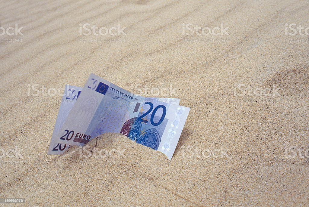 Euro Bills On Sand royalty-free stock photo