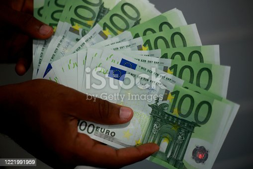 salvador, bahia / brazil - february 11, 2015: Hands hold Euro banknotes, currency used in the European Union.
