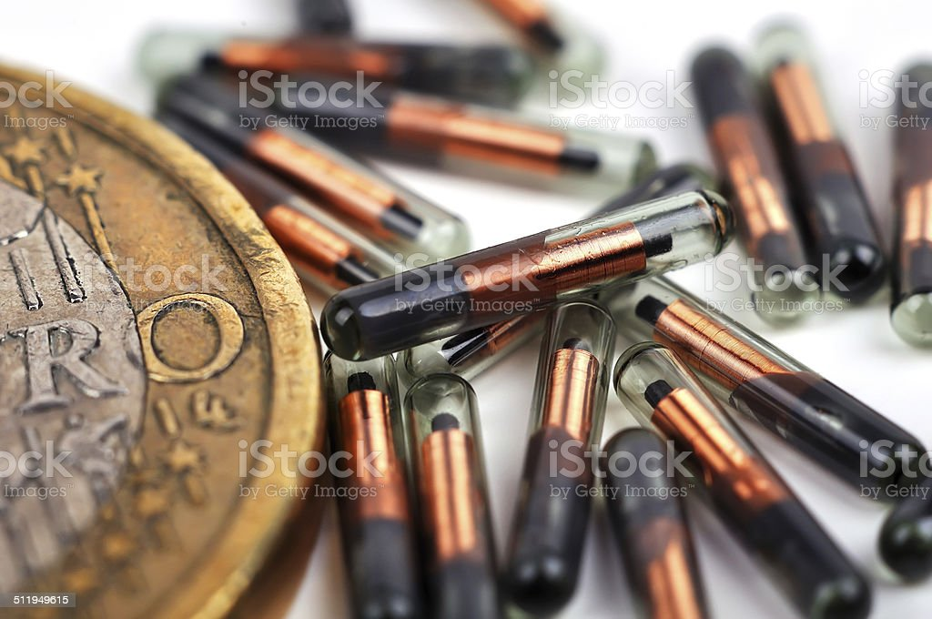 euro coin and id implants stock photo