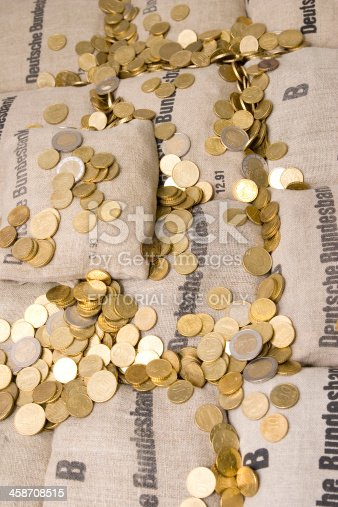482747823istockphoto Euro Coin Bags 458708515