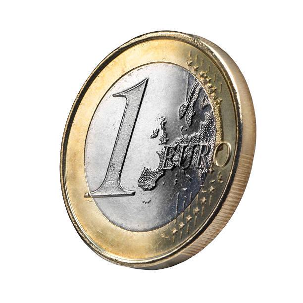 Euro coin isolated Close up Euro coin view against white background. Clipping path. Original texture with a soft treatment to give up an ancient or jewelry presence. european union coin stock pictures, royalty-free photos & images