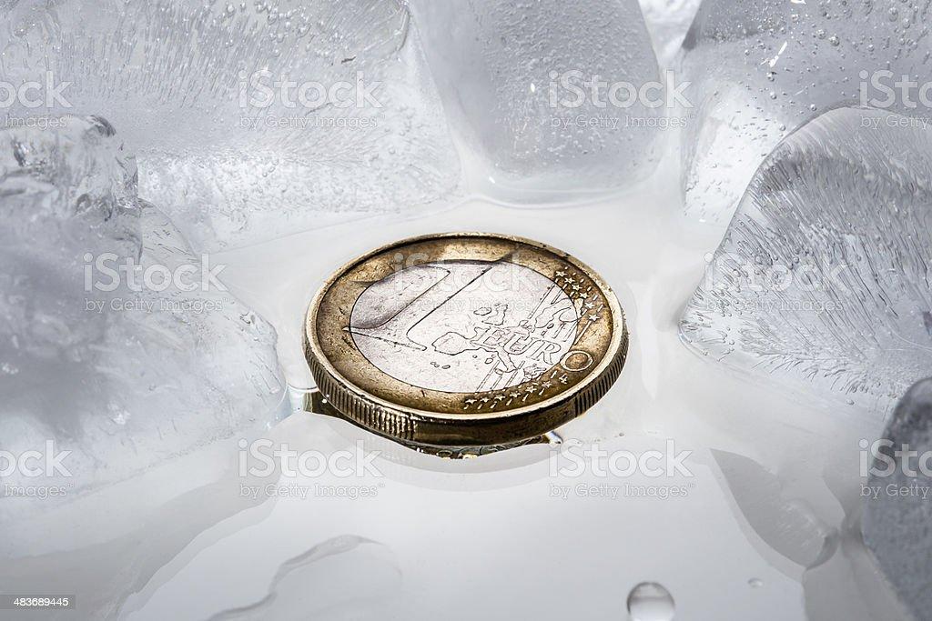 Euro coin on ice stock photo