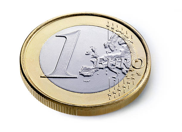 Euro coin A one euro coin isolated on white background european union coin stock pictures, royalty-free photos & images