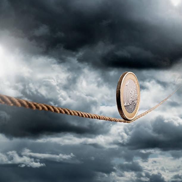 1 euro coin rolling unto a rope stok fotoğrafı