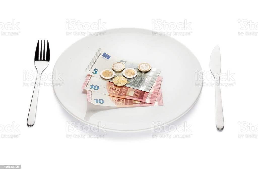 Euro coins and banknotes on a white plate stock photo
