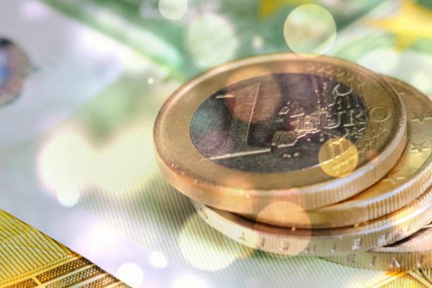 Euro coins and euro banknotes stock photo