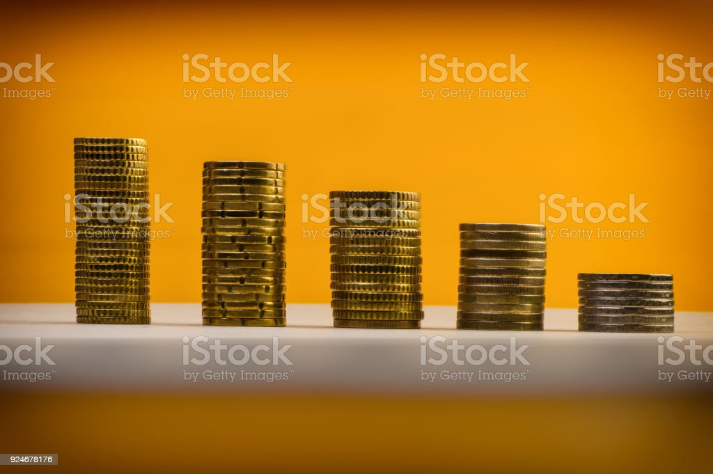 Euro coins and eurocents stacked on a yellow background. Euro money. stock photo