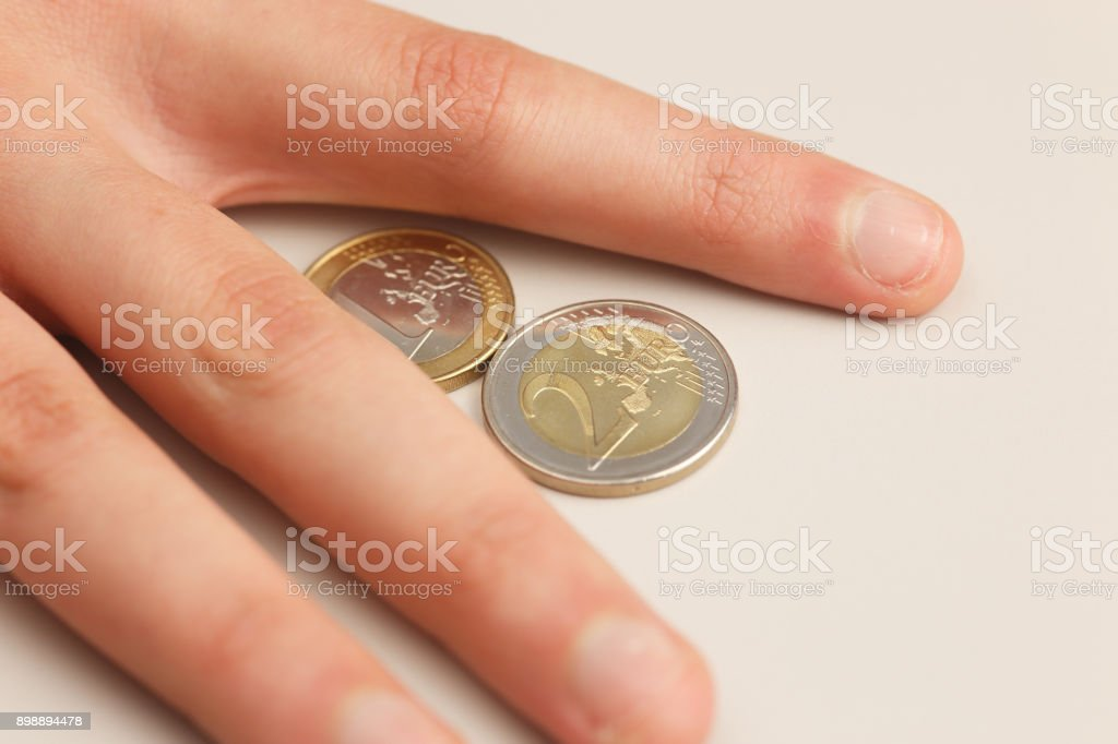 Euro coins and human hand stock photo