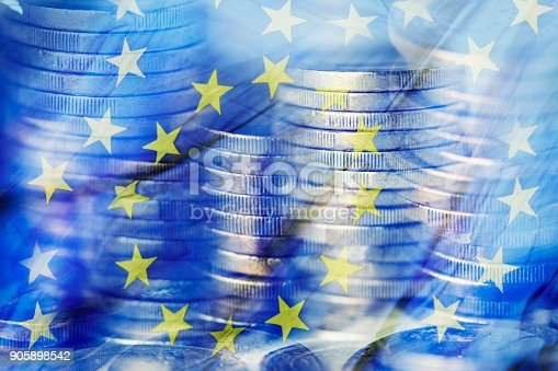 istock euro coins and the flag of the European Union 905898542