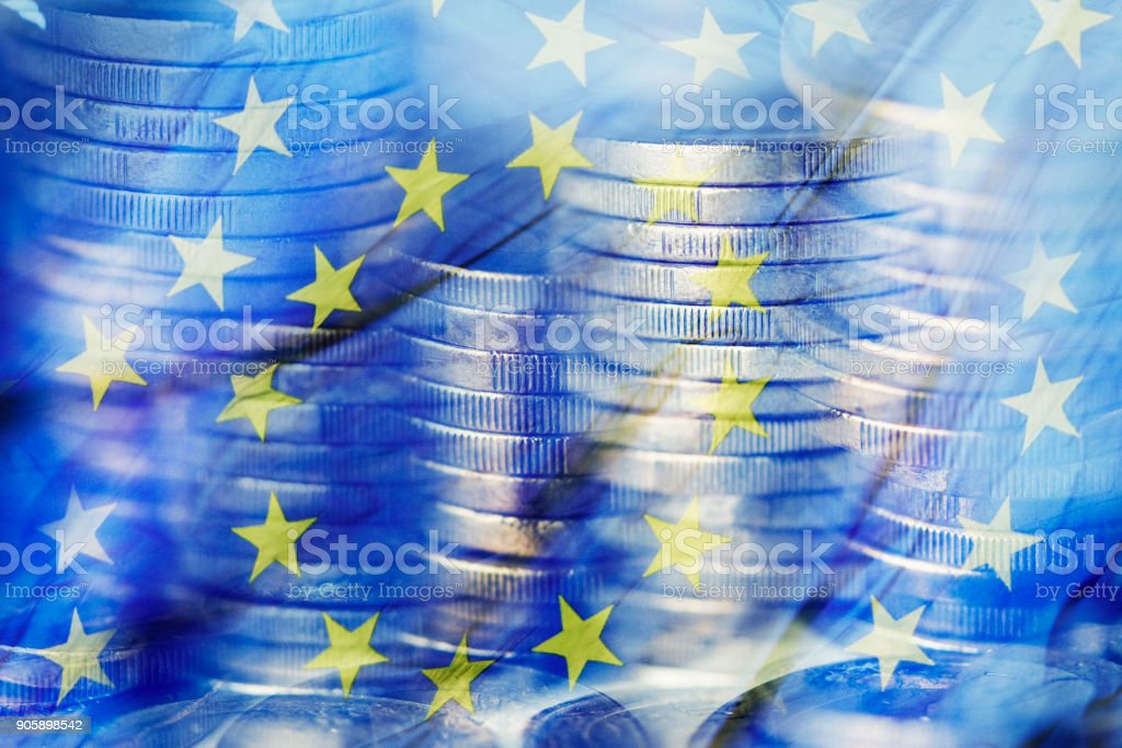 euro coins and the flag of the European Union - foto stock
